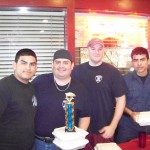 The firemen win the Sticky Lips BBQ rib-eating contest in 2012